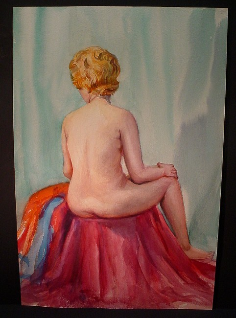 red-haired woman sitting (back)