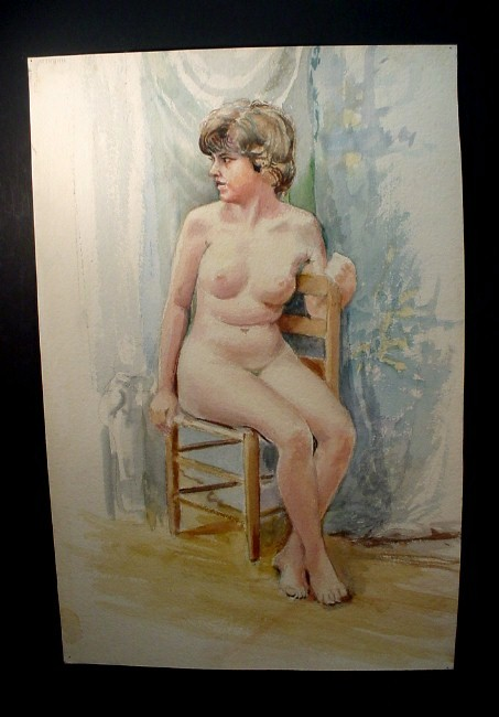 brown-haired woman in chair