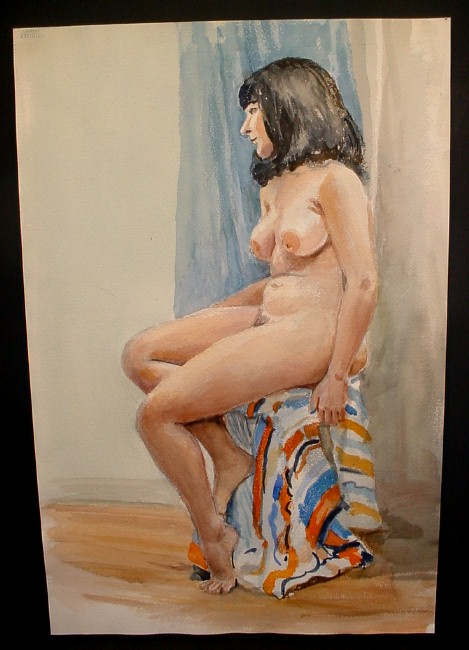 dark-haired woman on striped blanket