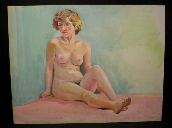 light-haired woman sitting on floor