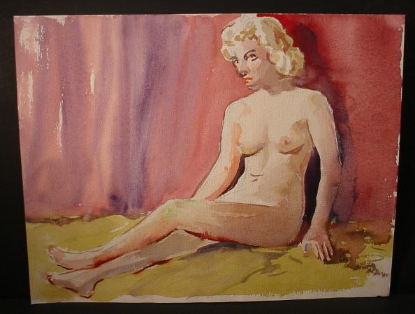 blonde woman sitting on floor